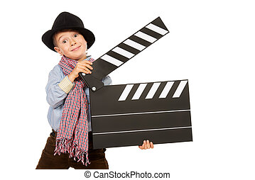 entertainment - Cheerful boy holding clapper board....