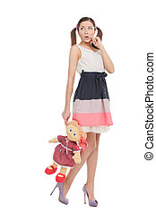 Teenage girl with toy. Full length of beautiful young woman...