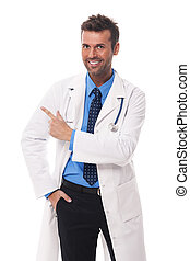 Happy doctor pointing at copy space