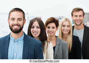 Successful team leader - Successful young bearded male team...