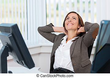 Happy businesswoman stretching - Happy businesswoman sitting...
