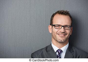 Close-up portrait of a friendly businessman