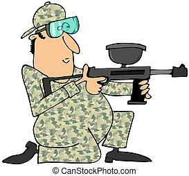 Man aiming a paintball gun
