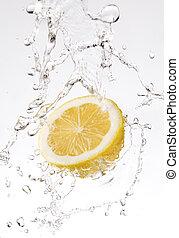 splash of water on lemon close up shoot