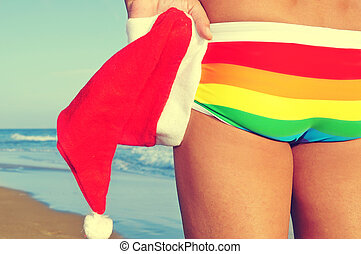 christmas at the beach - someone at the beach wearing a...