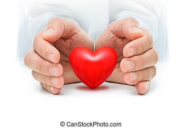 Heart at the human hands - Red heart is protected by the...