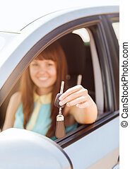 happy woman holding car key - vehicle, rental, automotive...