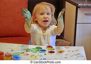 Girl draws - Little girl draws paints children's hands at...