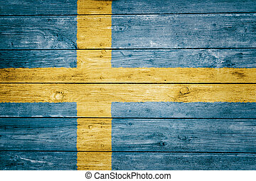 swedish flag on wood texture background
