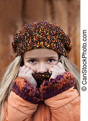 Little girl in the cold autumn