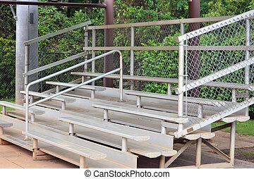 Bleachers - A set of metal bleachers in an empty baseball...