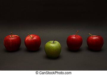 Apple Exception - A line of apples with one exception.