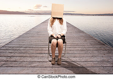 woman with a box in her face
