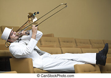Tromboninst - A trombonist in a white suit and yellow...