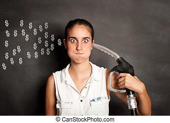 young woman with a fuel pump nozzle - young woman shooting...