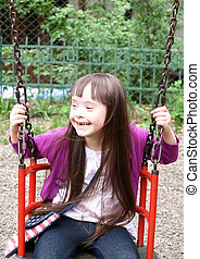 Portrait of beautiful young girl on the playground