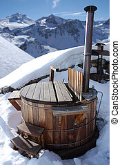hot tub - wooden hot tub in the alps with mountains behind