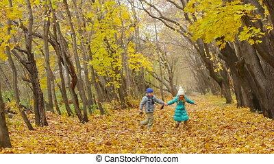 Childhood Friends - Cute kids walking in the autumn park...