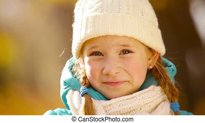 Cutie - Close-up portrait of a smiling cutie wearing...