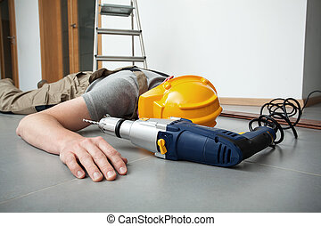 Accident at work - Manual worker is injured during drilling...