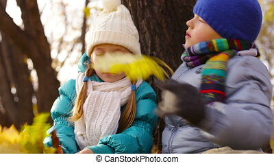 Kids With Leaves - Cute children being outdoors holding...