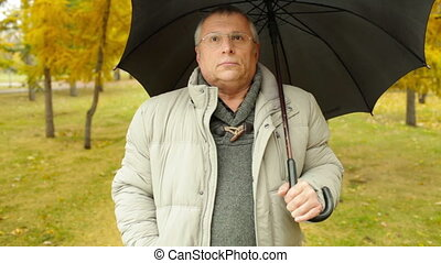 Senior Man - Senior man taking a walk on a rainy autumn day