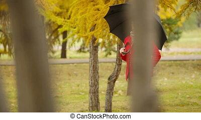 Red Coat, Black Umbrella - Elegant senior lady in red coat...
