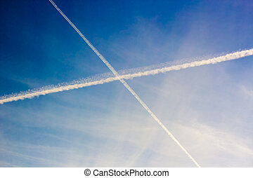 White trails in the sky - Intersecting roads white plane in...