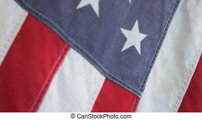 old USA flag - closeup view of old fabric American flag