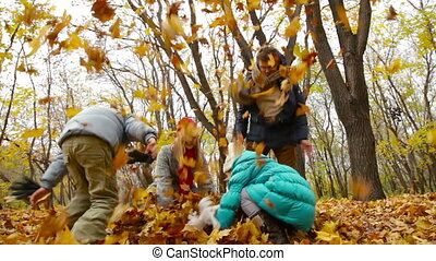 Heap Of Leaves - Parents and kids having fun throwing about...