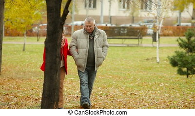 City Park - Senior friends walking together in the city park