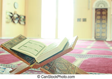 Reading Quran - The Muslim holy book, the Quran, open on a...