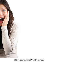 Shocked woman - Very surprised eurasian woman holding her...