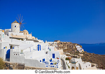 Windmill in Oia at Santorini island, Greece - vacation...