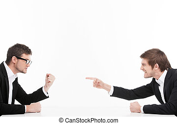 Men?s confrontation. Two angry young business people...