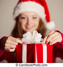 Christmas surprise - Beautiful smiling woman opening her...