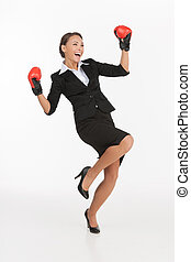 Businesswomen in boxing gloves Beautiful young businesswomen...
