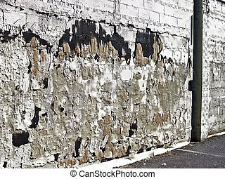 A blighted urban cinder block wall - An urban cinder block...