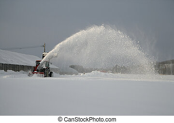 Snow clearing machine working in Japan