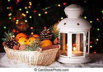 Christmas light - Christmas basket and candle lantern on the...