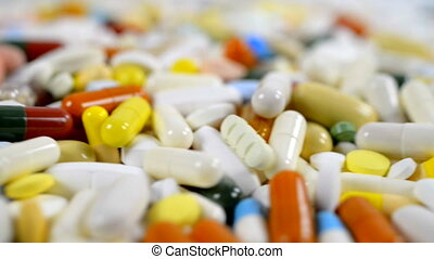 Medicine - Close-up of many different turning pills