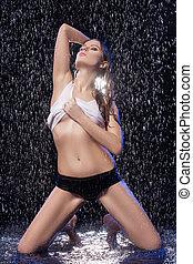 Wet beauty. Beautiful young women in wet T-Shirt undressing...