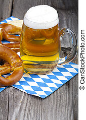 Glass of cold beer and pretzels - A cold beer in a beer...