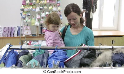 Dolly: Shopping in a clothing store - Mother and daughter...