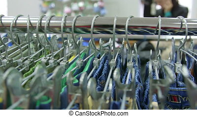Dolly: Hangers at Clothing Store - Clothes on hangers in...