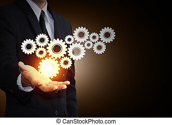 Gear to teamwork as concept - Business man hand show gear to...