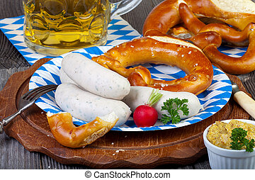 Typical Bavarian veal sausage snack on paper plate