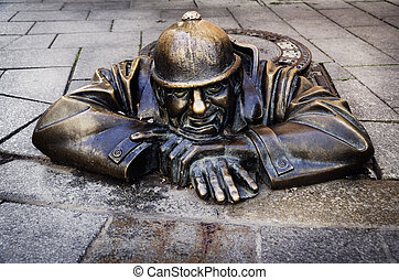 Man at work, Bratislava, Slovakia - Man at work, statue in...
