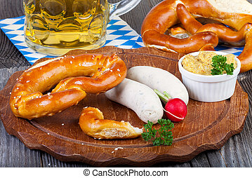 Veal sausage, Pretzels and Beer - Round wooden cutting board...