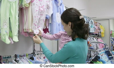 Children Clothing Store - Mother with little daughter...